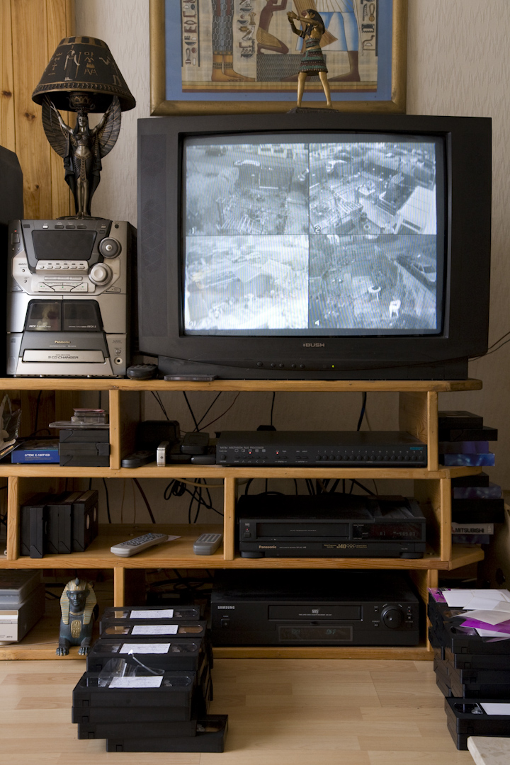 The television in Elizabeth's sitting room hooked up to the cctv installed after threats and vandalism.