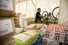 Kingsnorth 2008; The central kitchen store provides a spot out of the wind to repair a bike.