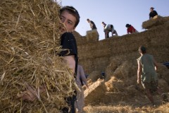 Kingsnorth 2008; Hay bales are unloaded to supply compost loos and structural needs.
