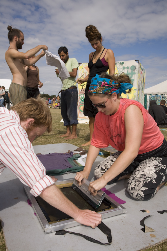 Blackheath 2009; Campers remove shirts to have them screen printed for The Climate Swoop.