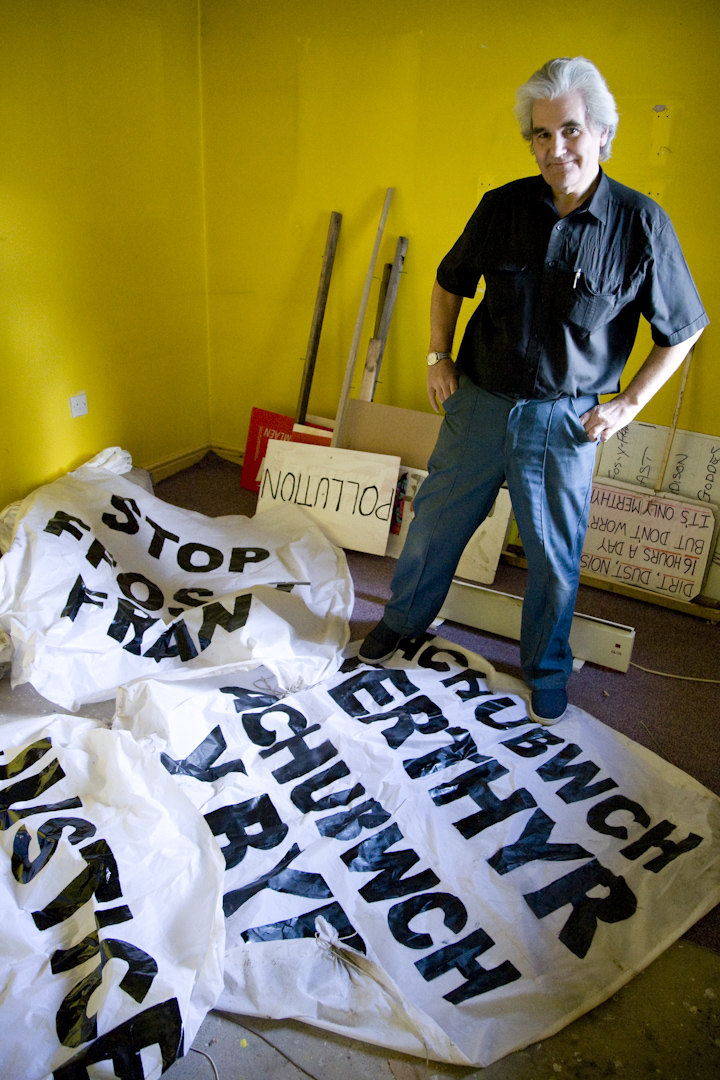 Terry with banners left behind from a recent protest at the mine.